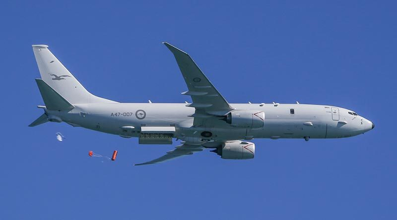 A Royal Australian Air Force P-8A Poseidon drops a life raft during training. Photo by Corporal Brendan Kwaterski.