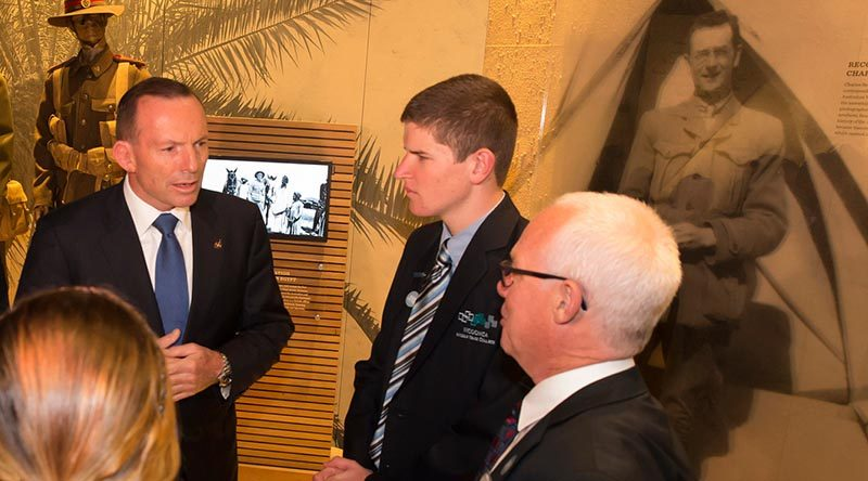 Then Prime Minister Tony Abbott speaks to fellow visitors to The Spirit of Anzac Centenary Experience travelling exhibition in Wodonga. Photo by David McCleneghan.
