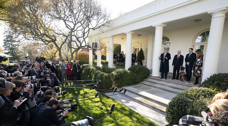 President Donald Trump, Vice President Mike Pence and First Lady Melania Trump present Conan to the media outside the White House, while the dog's special-forces handlers maintain their anonymity by staying in the Oval Office. White House photo.
