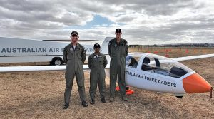 Glider pilot CUO Benjamin Dunk (No 613 Squadron) and aviation trainees CFSGT Tharane Thamodarar (No 604 Squadron) and CSGT Sean Fry (No 605 Squadron) with the AAFC DG-1000S glider operated by No 906 Aviation Training Squadron, at RAAF Edinburgh. Photo by Kerstin Hahn.