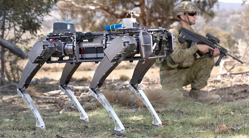A Ghost Robotics unmanned ground vehicle supports Australian soldiers in clearing an enemy position. Photo by Corporal Tristan Kennedy.