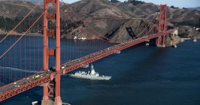 HMAS Brisbane under the Golden Gate Bridge during a port visit to San Francisco, California during her Combat System Qualification Trials.