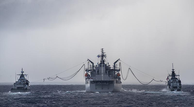 HMAS Sirius conducts a dual replenishment at sea with Malaysian ships KD Lekiu and KD Kelantan during her East Asia deployment. Photo by Leading Seaman Tara Byrne.