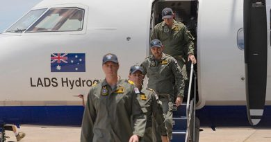 The last Royal Australian Navy's Laser Airborne Depth Sounder (LADS) flight crew exit their aircraft during the LADS Flight end of service ceremony at Cairns Airport, Queensland. Photo by Able Seaman Jarrod Mulvihill.