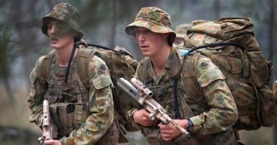 Australian soldiers march with packs at the Royal Australian School of Infantry in Singleton. Photo by Sergeant Janine Fabre.