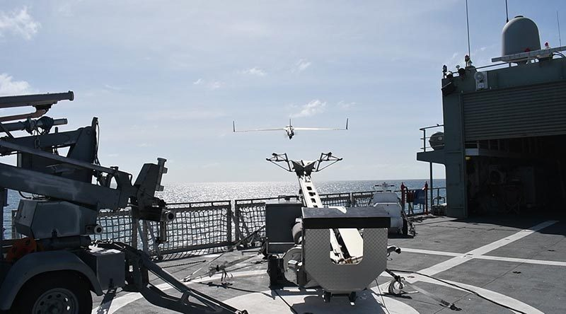 A ScanEagle remotely piloted aircraft is launched by pneumatic catapult from the flight deck of HMAS Leeuwin during first-of-class flight trials in real-world conditions on the ship's current Asian deployment. Photo by Lieutenant Michael Azoury.