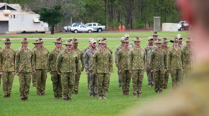 A reduced contingent of Australian and New Zealand soldiers and officers parade (in an apparently less-than-salubrious setting) during their official farewell from Robertson Barracks, Darwin, before deploying to the Middle East as part of Task Group Taji - Ten. Photo by Corporal Carla Armenti.