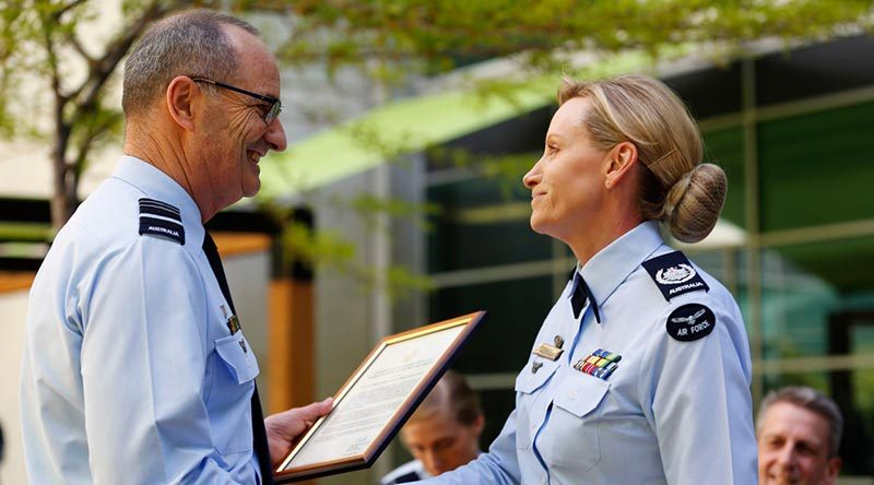 Chief of Air Force Air Marshal Mel Hupfeld congratulates Warrant Officer of the Air Force Fiona Grasby on her appointment as the ninth WOFF-AF, during a changeover ceremony at Russell Offices, Canberra. Photo by Corporal Veronica O'Hara.