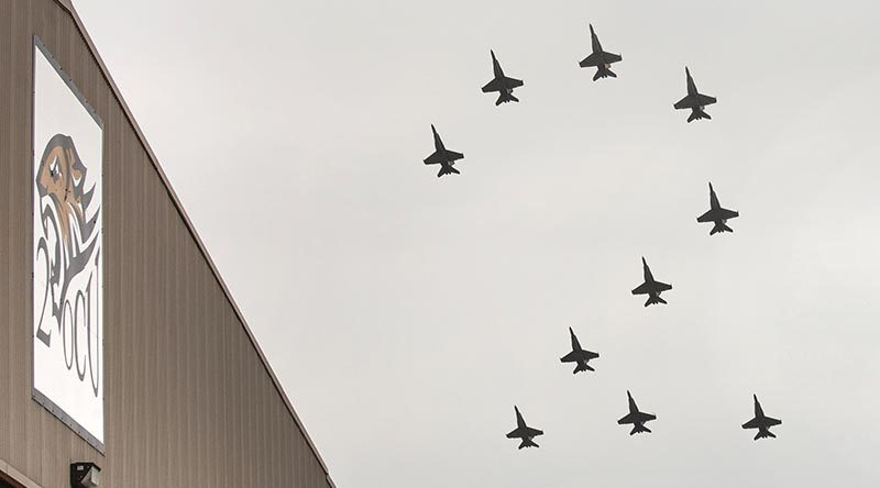 No. 2 Operational Conversion Unit conducts a formation flight, in the shape of a number 2 over their hangar at RAAF Base Williamtown. Two photos by Corporal Melina Young – digitally merged by CONTACT