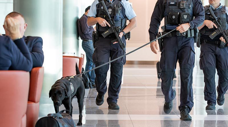AFP officers with short-barrelled rifles, body-worn cameras and explosives detection dog on patrol at an Australian airport. AFP photo.