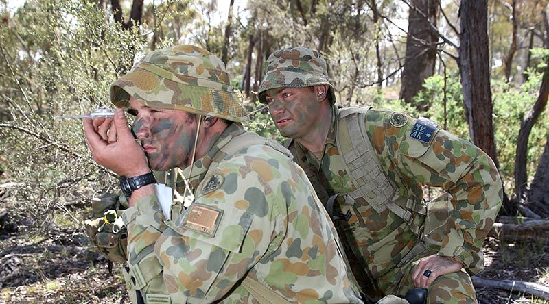 Staff Cadet Neil Fletcher shoots a compass bearing, supervised by Sergeant Wane Swan, at the Majura Training Area. Photo by Corporal Max Bree. Mid Cap: Sargent Wane Swan is an instructor of Third Class cadets at the Royal Military College, Duntroon. Third Class is the initial six months of training that teaches cadets basic soldier and section leadership skills.