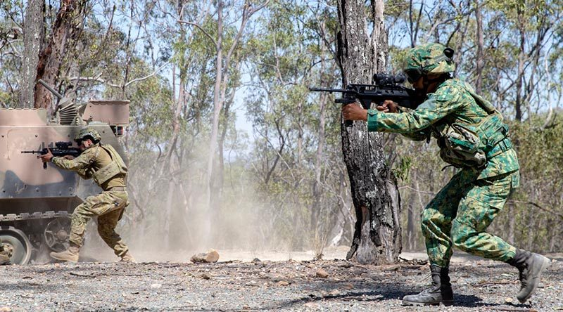 An Australian Army rifleman from Bravo Company 6RAR and a soldier from the Royal Brunei Land Forces take part in a section attack during Exercise Mallee Bull 2019, at Gallipoli Barracks, Queensland. Photo by Private Nicole Dorrett.