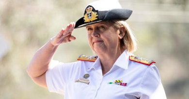 Newly appointed Commander Joint Health and Surgeon General of the Australian Defence Force Rear Admiral Sarah Sharkey salutes during a parade at Campbell Park Offices, Canberra. Photo by Jay Cronan.