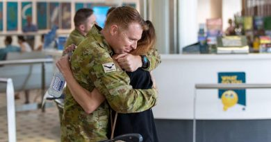 A member of TG Taji 9 is welcomed home to Brisbane after his deployment to Afghanistan. ADF photo.
