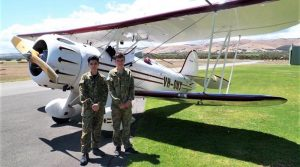 Cadets Sam Lotfi and Josh Bishop with the Waco biplane. Image by FLTLT(AAFC) Ian Harlow, 906 Aviation Training Squadron.