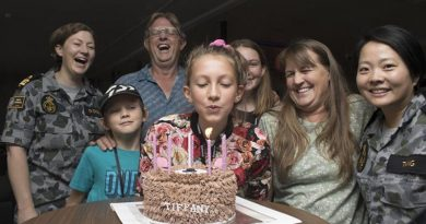 The Bragg family celebrate Tiffany's 12th birthday with their new Navy friends at the HMAS Harman bushfires evacuation centre.Photo by Lieutenant Ben Robson.