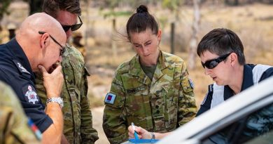 Lieutenant Matilda Connell and Corporal Trent Jones from the 3rd Combat Engineer Regiment conduct map reconnaissance with Deputy Incident Controller Emma Conway and Commander Mitch Simmons from the Country Fire Authority, to assess fire damage in Omeo, during Operation Bushfire Assist. Photo by Private Madhur Chitnis.