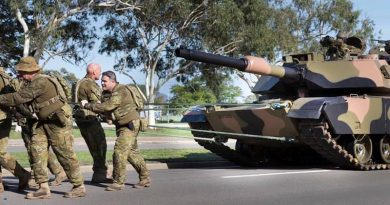 Soldiers of 2nd Cavalry Regiment in Townsville pull a 62-tonne Abrams tank – for PT.