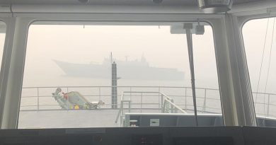 HMAS Adelaide as seen through the bridge window of MV Sycamore in Twofold Bay, New South Wales. Photo by Commander Brinckmann.
