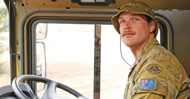 Australian Army soldier Private Jonathan Amey from the Brisbane-based 5 Transport Squadron, 7th Combat Services Support Battalion, in his HX77 heavy vehicle taking part in Operation Bushfire Assist. Photo by Sergeant Dave Morley.