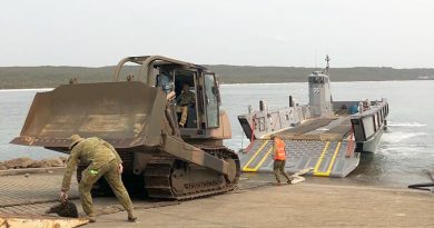 A bulldozer is landed at HMAS Creswell, Jervis Bay, from HMAS Adelaide.