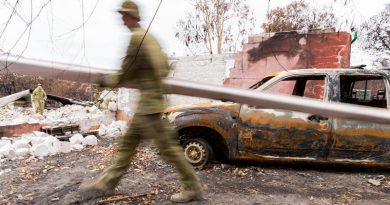 Soldier from the 12th/40th Royal Tasmanian Regiment clear debris from a home on Kangaroo Island that burnt down in the bushfires. Photo by Lance Corporal Brodie Cross.
