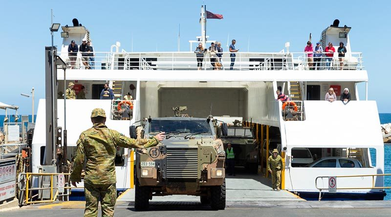 Reservists from the 10th/27th Battalion, Royal South Australia Regiment, load vehicles onto the Kangaroo Island ferry at Cape Jervis, South Australia, during Op Bushfire Assist. Photo by Corporal Tristan Kennedy.