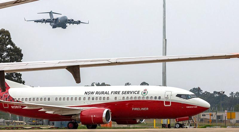 A Royal Australian Air Force C-17A Globemaster approaches RAAF Base Richmond carrying fire retardant donated by the United States to assist with fighting bushfires. RAAF photo.