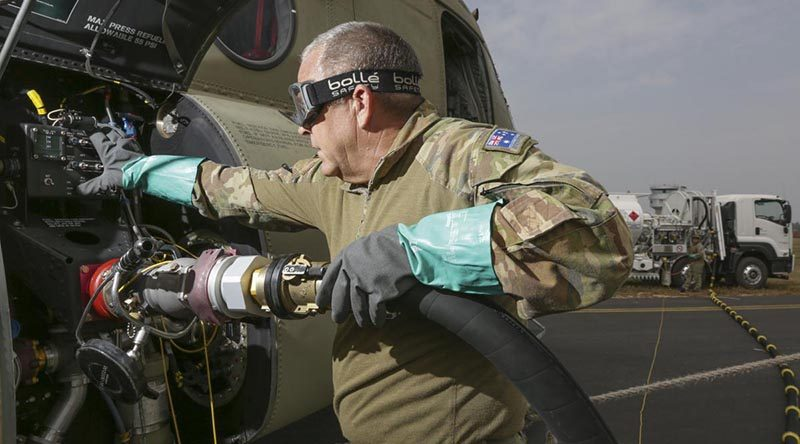 Sergeant Ian MacGregor refuels a Chinook helicopter at at RAAF Base East Sale in preparation for a mission during Operation Bushfire Assist. Photo by Corporal Kylie Gibson.