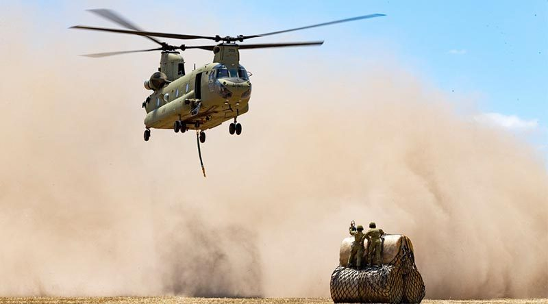 Australian Army CH-47 Chinook from Townsville-based 5th Aviation Regiment prepares to uplift hay bales to deliver to remote bushfire-affected farms on Kangaroo Island. Photo by Corporal Tristan Kennedy.