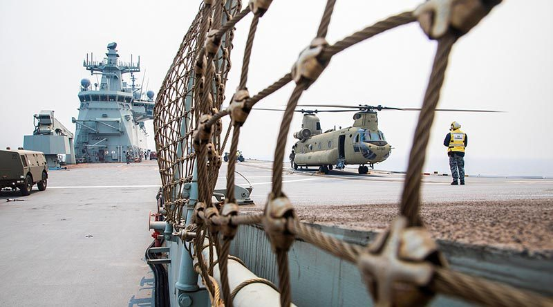 An Australian Army CH-47F Chinook helicopter loads stores on the flight deck of HMAS Adelaide during Operation Bushfire Assist. Photo by Petty Officer Tom Gibson.