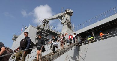 Evacuees from Mallacoota, Victoric, disembark HMAS Choules at Western Port. Photo by Petty Officer Nina Fogliani.