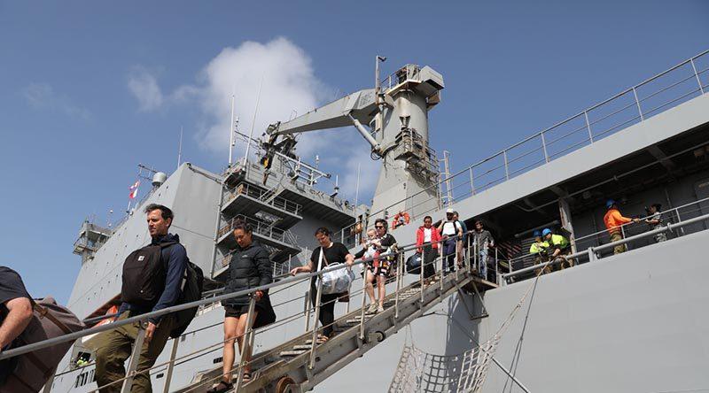 Evacuees from Mallacoota, Victoric, disembark HMAS Choules at Western Port. Photo by Petty Officer Nina Fogliani.