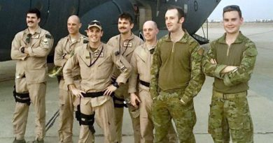The crew of Mambo 21 stand in front of a Royal Australian Air Force C-130J Hercules at Baghdad International Airport. Flight Lieutenant Brendan Carraro, the aircraft captain, is pictured third from the left (wearing a cap).