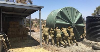 Australian Army soldiers from 16 Regiment Emergency Support Force assist in flushing a contaminated water tank near Lobethal, South Australia.