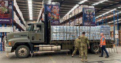 Soldiers from 15 Force Support Squadron load pallets of water at the Foodbank Victoria warehouse in Melbourne. Photo by Corporal Sebastian Beurich.