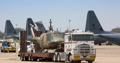 Retired UH-1H Iroquois helicopter A2-776 is trucked onto RAAF Base Richmond for storage en-route to its final destination in a RAAF heritage collection. Photo by Corporal David Said.