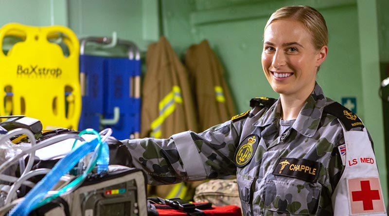 Leading Seaman Medic (Underwater) Kiah Chapple prepares medical equipment in the flight deck triage onboard HMAS Adelaide. Photo by Able Seaman Thomas Sawtell.
