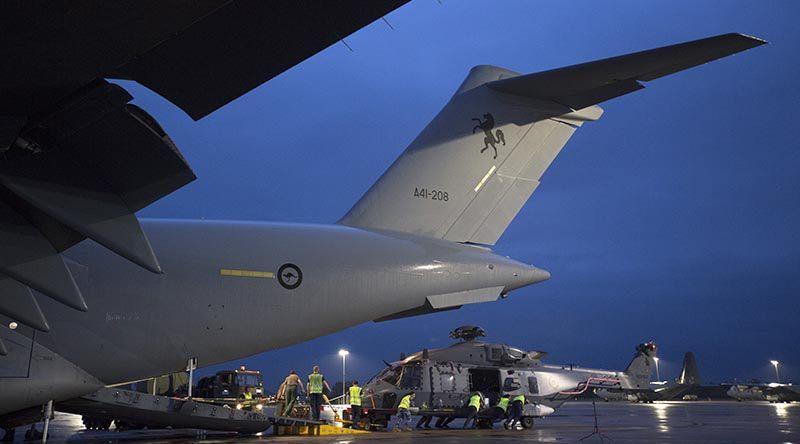 A Royal New Zealand Air Force NH-90 is unloaded off a Royal Australian Air Force C-17A Globemaster III aircraft at RAAF Base Richmond during Operation Bushfire Assist 19-20. Photo by Corporal Nicci Freeman.