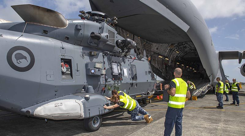 A RNZAF No.3 SQN NH90 helicopter is loaded onto a RAAF C-17, on its way to assist with the Australian bushfires. NZDF photo.