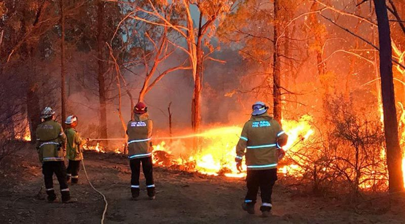 Lieutenant Matt Urquhart from HMAS Albatross fights a fire on the New South Wales south coast as a member of the NSW Rural Fire Service, during the 2019-20 Australian bushfire crisis.