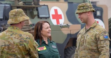 St John Ambulance Registered Nurse Diana Wong chats with Australian Army medic Private Brenden Walker from the 1st Combat Health Battalion at Batemans Bay. Photo by Sergeant Bill Solomou.
