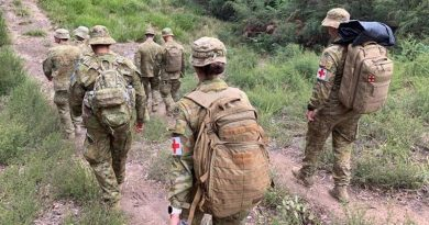 Australian Army soldiers from the 7th Battalion, Royal Australian Regiment, move on foot into the isolated community of Gipsy Point, north-west of Mallacoota, Victoria, to provide health support. Photo by Major Gavin Cole.