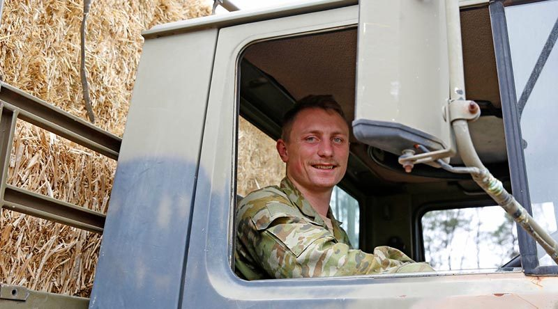 Australian Army Reserve soldier Private Jonathan Catt, a Unimog truck driver with 16 Transport Squadron, 8th Combat Services Support Battalion, from Newcastle, delivering fodder to farmers during Operation Bushfire Assist 19-20. Photo by Sergeant Dave Morley.