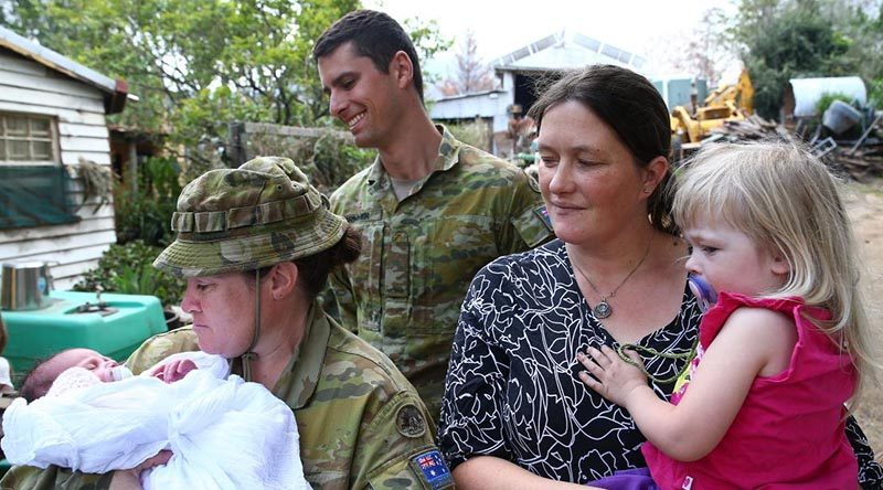 Corporal Kristie Connell, of the 8th Combat Service Support Battalion, and Private Nicholas Brimmer, of the 2nd/17th Battalion, Royal New South Wales Regiment, with Sarah and Ruby Tyrrell and baby Ivy. Photo by Sergeant Max Bree.