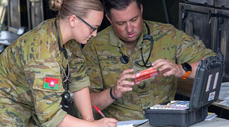 Australian Army nursing officer Lieutenant Alison Stock and medic Corporal Leigh Smith from 1st Combat Health Battalion conduct daily medication checks at Batemans Bay evacuation centre during Operation Bushfire Assist 19-20. Photo by Sergeant Bill Solomou.
