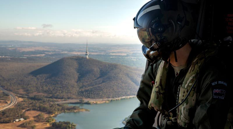 Royal New Zealand Air Force loadmaster Corporal Tom Hanson over Canberra during a 7RAR transportation task to Brindabella Mountain, west of of the capital. Photo by Signalman Robert Whitmore.