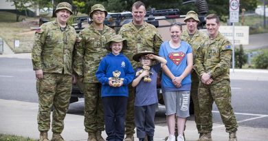 Chaplain Phil Linden, Lieutenant Henry Vong, Sergeant Glenn Ludeman, Warrant Officer Class One Anthony Jones and Lieutenant Colonel Daniel Strack with Omeo locals Jackson, Ryan and Rebecca, back home in Omeo. Photo by Corporal Sebasitan Beurich.