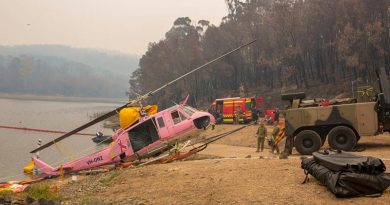 An Australian Army Heavy Recovery Vehicle is used to recover a NSW Rural Fire Service-contracted helicopter that ditched in the Ben Boyd Reservoir near Eden, NSW. Photo: Sergeant Bill Solomou.