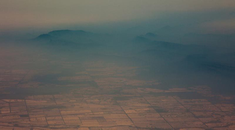 Smoke haze over mountains near Cooma, New South Wales, as viewed from a No 11 Squadron P-8A Poseidon conducting damage assessment and surveillance in the bushfire-affected area. Photo by Sergeant Murray Staff.